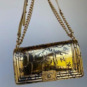 crocodile embossed printed gold leather boy bag